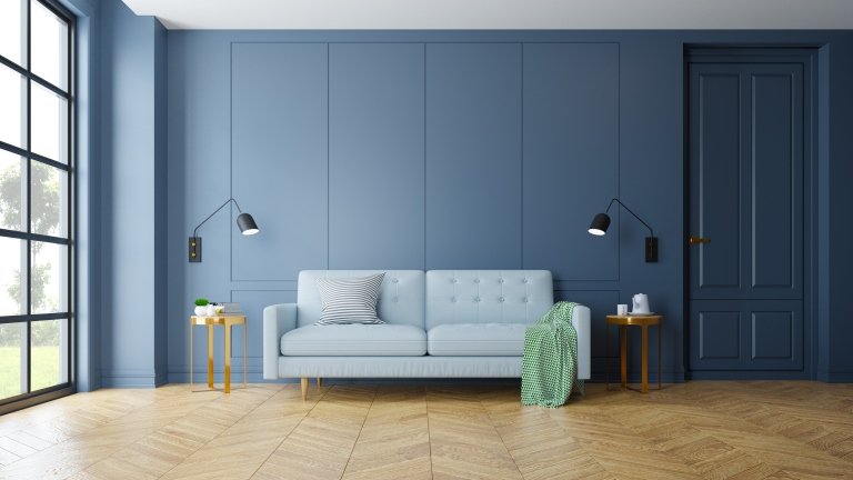 Vintage Modern interior of living room, blue sofa near black lamp and gold table on parguet flooring and dark blue wall  ,3d rendering